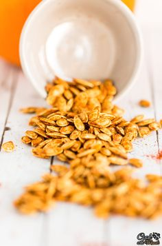 Spicy roasted pumpkin seeds are healthy to snack on. They are also delicious on top of soups and salads! #healthy #pumpkin #snack