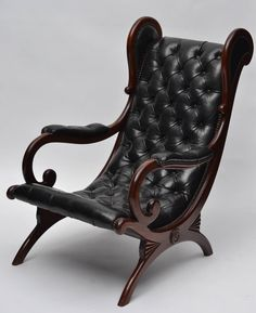 Vintage Leather and Mahogany Wingback Lounge Chairs | From a unique collection of antique and modern wingback chairs at https://www.1stdibs.com/furniture/seating/wingback-chairs/