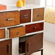 I like the different shades of natural wood color and the various hardware (drawer pulls).