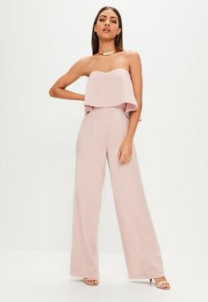 Strapless jumpsuit in a pink hue with wide leg detail.