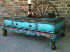 I purchased this coffee table from a local 2nd hand store, I added new life to it by highlighting the ornate raised details with cool  clear turquoise paint  dark walnut stain, I Love the way it turned out