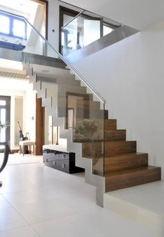 Modern staircase. Thinking of installing safety gates at the top (same style) & an extra lower handrail for the little one to grab hold of.