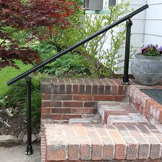 Extend Stair Rails - The handrails for exterior stairs typically end at the bottom step. But stepping off the bottom step (or preparing to step up on it) is actually when someone is the most off balance and likely to fall. Simple Rail handrail kits from S Porch Step Railing, Exterior Stair Railing, Wrought Iron Stair Railing, Porch Stairs, Stair Handrail, Handrail Ideas, Hand Railing, Outside Handrails, Porch Handrails
