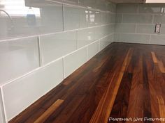 Smoke Grey glass subway tile backsplash and walnut butcherblock countertops,
