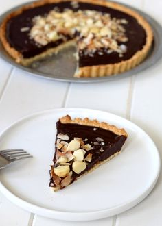 This Dark Chocolate, Coconut & Macadamia Nut Tart is decadent and delicious, and you'd never guess it was gluten free, vegan, Paleo, and refined sugar free!