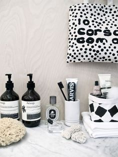 polka dot 10 corso como towel, aesop products, parvis toothpaste. minimalist apothecary in black and white