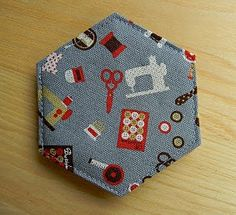 Contemporary, hexagon needle book.  Instructions at: http://megsmonkeybeans.blogspot.com/2010/08/hexagon-needle-book-tutorial.html
