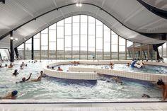 The fantastically curvy Mantes-La-Jolie Water Sports Center in Paris, France.