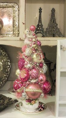 Ms Bingles Vintage Christmas - Lots of  lovely items on this site... really like this vintage ornament Christmas tree set on a teacup!