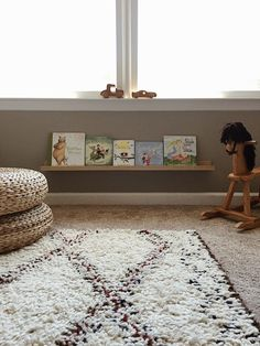 Ikea shelves in neutral nursery Montessori style