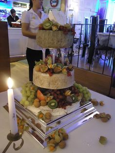 "We really wanted to have a ""cake of cheeses"" aka cheese tower, to serve in addition to our more traditional wedding cake, but it wasn't possible at our venue. :( I love the abundance of fruit with this cheese ""cake""."