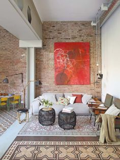 Living room in a Barcelona home with exposed brick and beautiful tiled floor