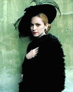 Madonna as Evita photographed by Mario Testino, 1996. Derby hat.