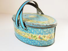 Blue Lunchbox - Lithographed 'Tindeco' Basket - Lid and Handles - Perfect For Storing - Bright, Cheery Blue - Great Graphics For the Shelf by TheBrownSuitcase on Etsy https://www.etsy.com/listing/187625120/blue-lunchbox-lithographed-tindeco