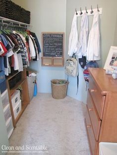 walk-in closet for 3 kids. I love the chalkboard with morning routine on it :)