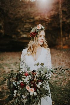Bohemian-inspired bridal look with a long-sleeved lace gown, bold flower crown, and incredible bouquet | Image by The Marions