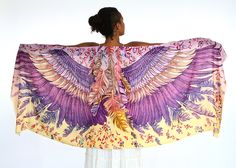 This wings and bird feathers shawl scarf features:  Hand-painted and digitally printed Art of Wide - Spread Wings, this highly detailed representation of