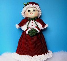 **PLEASE NOTE THAT THIS IS A PATTERN ONLY - NOT THE FINISHED MRS SANTA** Every Santa needs a Mrs., so here she is. She is a hardy little woman who greatly helps her hubby at Christmas time. She stands about 15 tall. She is crocheted almost entirely using sc with soft acrylic yarn. She has