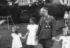 Holde, Helga, and Hedda walking with Rommel during his visit. Mother Magda, carrying Heide, following not far behind.