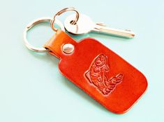 Click To Shop Now – Handmade Leather Keyring, Leather Keychain, Why not check out my Etsy shop? #trout #fishing #keyring #leather #keychain #animal #handstamped #birthdaygift #christmasgift Leather Bookmark, Leather Keyring, Leather Gifts, Leather Craft, Handmade Leather, Handmade Birthday Gifts, Handmade Christmas Gifts, Gifts For My Boyfriend, Gifts For Dad