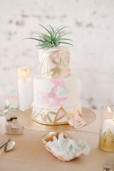 Pastel and gold geometric wedding cake by Kien & Sweet.