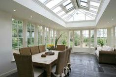 An Orangery is similar in construction to a Conservatory with some key differences in the frame, base and roof. Orangeries often have a flat perimeter roof with a central roof lantern. Edwardian Conservatory, Small Conservatory, Orangery Conservatory, Orangerie Extension, Edwardian Haus, Decor Interior Design, Interior Decorating, Modern Georgian, Georgian Interiors