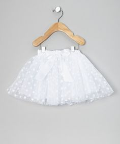 Tiny dancers will have a twirl of a time in this terrific flouncy tutu. With a playful polka dot print, a silky bow and cozy elastic waistband, this frilly fashion sets the style bar high.
