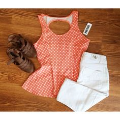 Peach Polka Dot Peplum Peach and white peplum. Has cut out circle in back. Never worn. Tags still attached Kirra Tops Tunics