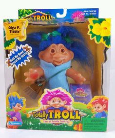This is a new in box, Dam Series 1 Totally Troll Doll. The name of the doll is Olga P Tiddle. The tape on bottom of box appears to have been lifted once, but the doll is still strapped in box and the accessories appear untouched, in new condition.   eBay!