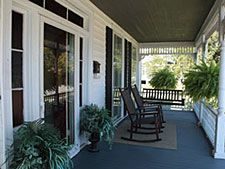 House front porch, where Minnie and Lily spend summer days and nights
