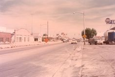 Logan Library - Historic Photo Collection: Logan's Main Street. Date: 1973. Address: 900 North Main Logan, Utah - Northward .  The scene is looking North from about 900 North and northward. At the time that this photograph was taken, main street from about 10th north on to Smithfield was under construction with the goal of widening the road. Photographer and Source: Logan Beautification Committee (1973).