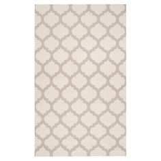 Wool flatweave rug with a quatrefoil motif. Handmade in India.   Product: RugConstruction Material: 100% Wool