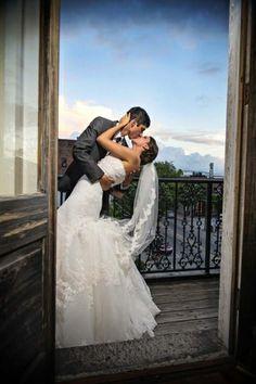 Bride and groom kissing. The Balcony on Dock, Wilmington, North Carolina. Bella Rose Photography www.bellarosephoto.com