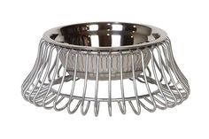 Castro Pet Bowl is influenced by Mid-Century Modern design. The collection of pet bowls blends beautifully in with any type of décor. Constructed of steel wire and finished in a platinum color, it is perfect for indoor or protected outdoor spaces. Available in three sizes.