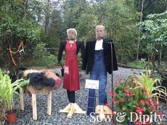 33 Cool Scarecrow Ideas - American Gothic scarecrow couple and a cow!