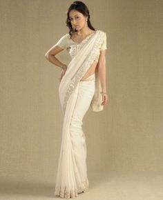 Ivory sequin saree with brocade blouse  $300