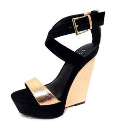 Gorgeous open-toe sandals buckle at the ankle and are designed with a criss-cross strap on the front with a gold-metallic strap...