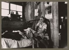 Mrs. Caudill and her daughter in their dugout, Pie Town, New Mexico. The Caudills have one of the few radios in their neighborhood, and many farmers and their families visit the Caudills on winter nights to listen to music and news and play Forty Two. 1940 June. Library of Congress.