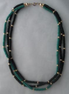 """Turquoise and Black Bead Multi-Layered Necklace. Intertwined turquoise and black small bead necklaces with gold bead accents. Gold colored snap together closure. 19.5"""" long from end to end."""