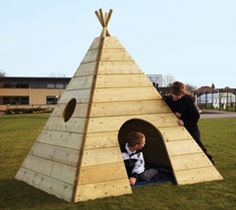 Wooden teepee - this is what I want to build. But, imagine it with solid corners, so the faces could be play structures - rock climbing on one side, a rope climb on another, a slide on the last! A great place to camp out with friends!