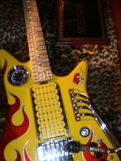 Nigel Tufnel (Spinal Tap) guitar with either 8 single coil or 4 dual coil pick-ups. Either way I would love to just play this guitar once!