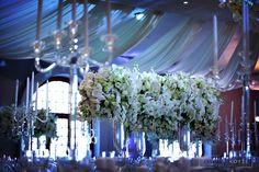 Four thousand Candles, mass arrangements, white roses, hydrangeas, orchids big floral arch. White Roses Wedding, Floral Arch, Event Company, Event Management, Hydrangeas, Orchids, Wedding Planner, Floral Design, Candles