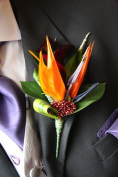 Birds of Paradise boutonniere, really like this choice! Description from pinterest.com. I searched for this on bing.com/images