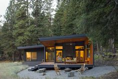 Dwell's Top 10 Cabins of 2017 - Photo 2 of 10 - By day, the Chechaquo Lot 6 cabin gives the impression of floating in a forest clearing; by night, its windows glow against the wooded darkness. From all vantage points, the landscape permeates this 1,000-square-foot cabin, designed for two outdoor enthusiasts and tucked at the toe of a dramatic slope in Winthrop, Washington.