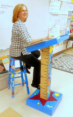 OK I absolutely adore this personalized teacher podium with matching stool. I need someone crafty to make me one!