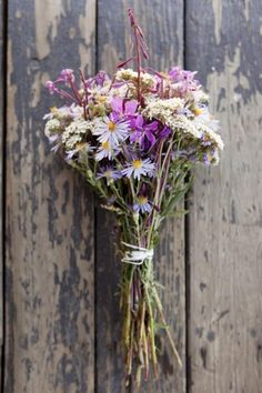 a bunch of handpicked flowers wrapped mesilly in twine. via Wild Child / Wedding Style Inspiration / LANE (PS - Follow us on instagram: the_lane)
