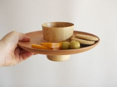 Bagel plate by Oji Masanori. One side is a plate with a cup holder, the other side is a trivet/coaster! Love the beautiful wood.