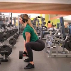Leg Booty with Dumbbells - Stand with your feet slightly wider than hip-width apart, holding a pair of dumbbells at your sides. Hinge forward at your hips and sit your butt back into a squat. Bend your knees until your thighs are parallel to the ground Fitness Workouts, Gym Workout Videos, Fitness Workout For Women, Sport Fitness, Fitness Tips, Leg And Glute Workout, Dumbbell Workout, At Home Workout Plan, At Home Workouts