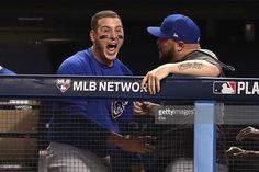 Anthony Rizzo #44 of the Chicago Cubs reacts in the dugout after Willson Contreras #40 (not pictured) hit an RBI double to score Ben Zobrist #18 (not pictured) during the fourth inning against the Cleveland Indians in Game Seven of the 2016 World Series at Progressive Field on November 2, 2016 in Cleveland, Ohio.