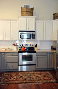 two tone painted kitchen cabinets. Upper level up a bit in middle over exhaust fan